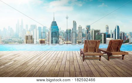 Empty wooden deck and chair with swimming pool Beautiful pool side view with city skyline .