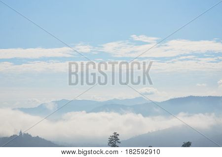 mist and cloudy cover mountain on sunshine day