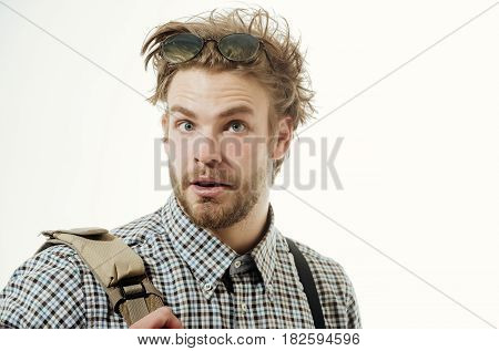 Feelings and facial emotions. Handsome man or smart male student businessman with surprised bearded face and nerd glasses on head stylish blond hair in checkered shirt with suspenders