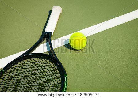 The green tennis ball on a tennis court