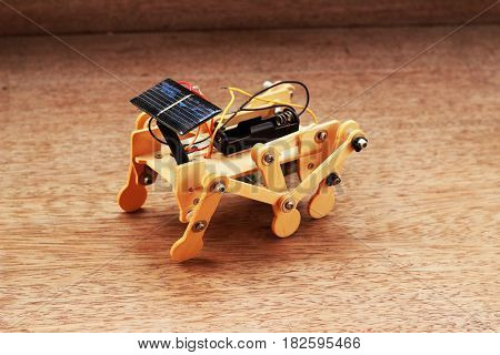 Artificial wood car using solar panels placed on a brown background