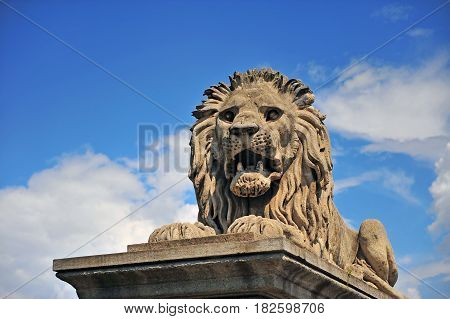 Stone lion monument in the Chain bridge of Budapest
