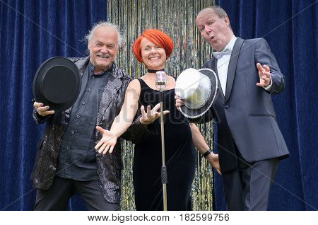 Three Lively Performers On Stage