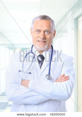 Closeup portrait of a happy senior doctor with stethoscope