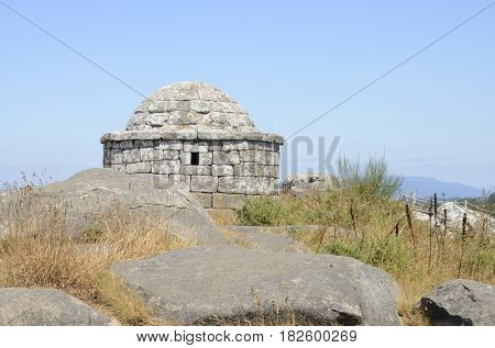 Circular watchtower with walls and stone vault at the top of the summit of Facho Mountain in Cangas in the province of Pontevedra Galicia Spain.