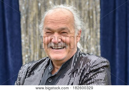 Happy Older Man With His Hair In A Ponytail