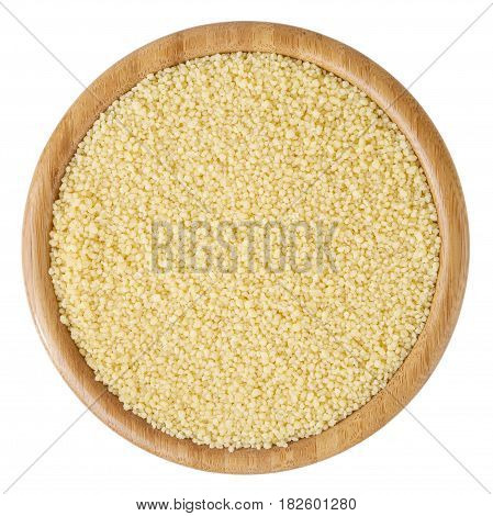 Uncooked couscous in wooden bowl isolated on white background with clipping path