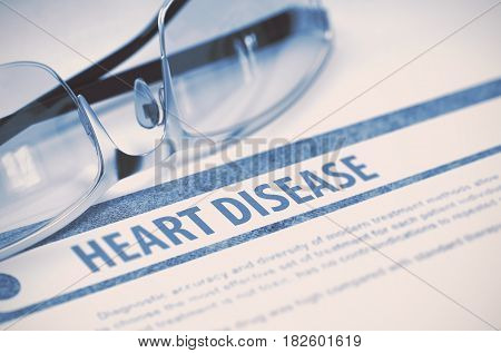 Heart Disease - Medicine Concept on Blue Background with Blurred Text and Composition of Eyeglasses. 3D Rendering.