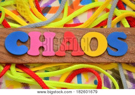 WORD CHAOS ON A  ABSTRACT COLORFUL BACKGROUND