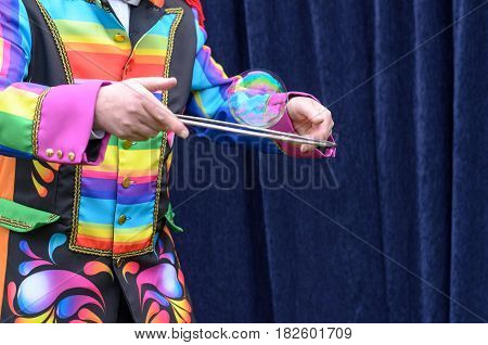 Performer In A Bright Costume Encircling A Bubble
