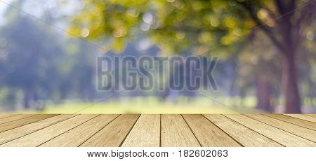 Empty table perspective wood over blur trees with bokeh background product display montage background banner