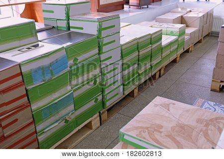 Boxes with building materials in wholesale warehouse