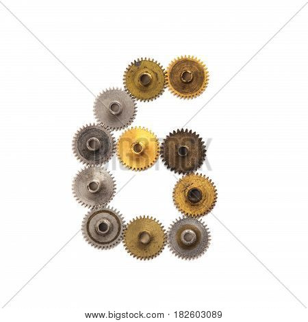 Digit numeric six steampunk cogs gears mechanism. Textured iron bronze metallic surface numeral 6. Aged mechanism wheels connection concept. White background, macro view.