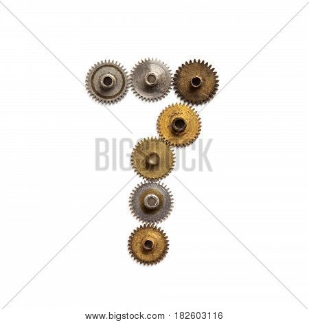 Vintage gears cogwheels steampunk style mechanical digit number seven. Rusty iron bronze metal texture shape 7. Aged mechanism wheels transmission connection concept. White background, close-up.