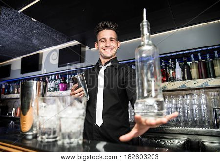 Flair bartender in action behind the club bar
