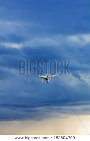 View on multicopter flight on natural blue sky background