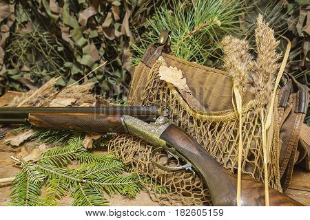 still life: beautiful hunting rifle and equipment