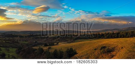 Winter travel vacation nature panoramic background mountain range snow peaks and blue sky with clouds closeup, Pirin, Bulgaria