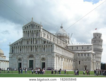 Pisa, Italy - May 03, 2010: Campo dei Miracoli - Tourists visiting the exterior of the Baptistery, the Cathedral and the Leaning   Tower of Pisa