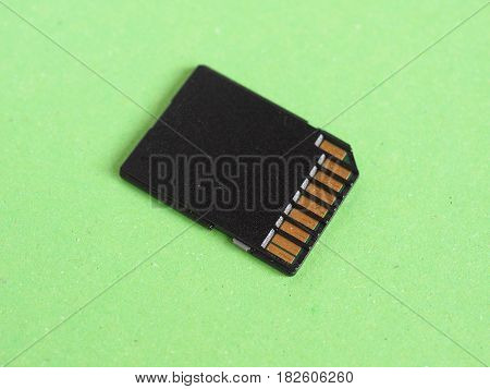 Sd Flash Card Over Green
