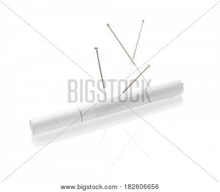 Acupuncture needles with cigarette on white background