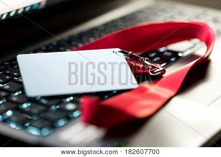 Customer service representative's ID badge on computer