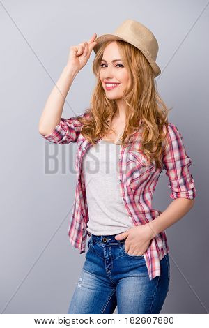 Vertical Portrait Of Attractive Young Girl With Beaming Smile Dressed In Checkered Shirt And Jeans H