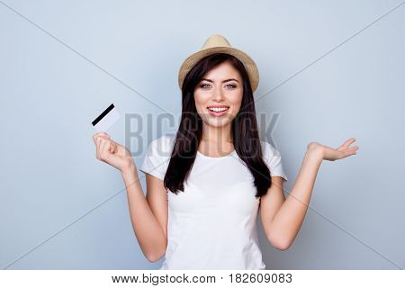 Time For Shopping! Happy Excited Young Girl In Summer Hat Holding Credit Card On Gray Background