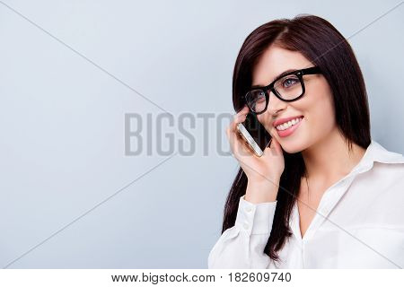 Close Up Portrait Of Confident Smiling Young Secretary In Spectacles Calling To Her Boss