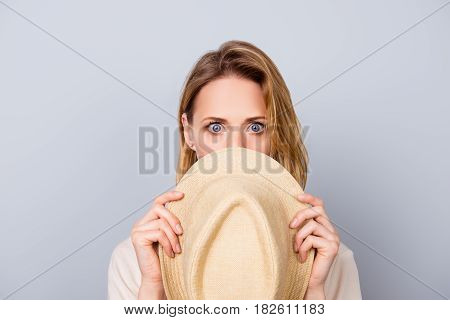 Close Up Portrait Of Cute Young Woman Keeping Silence And Hiding Her Face Behind Hat