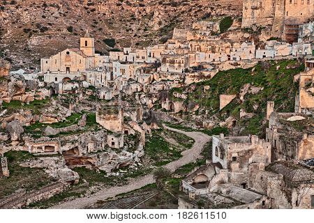 Ginosa, Taranto, Puglia, Italy: landscape of the old town with the ancient church and the cave houses carved into the tufa rock