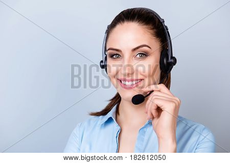 Close Up Portrait Of Smiling Consultant Of Call Center In Headphones Isolated On Gray Background