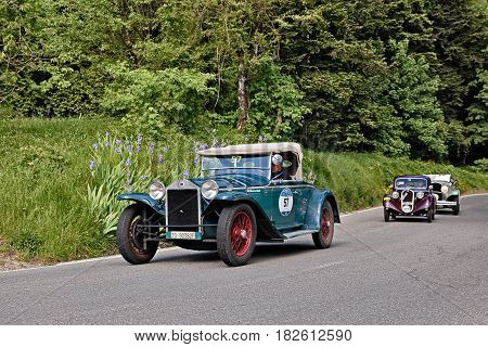 PASSO DELLA FUTA (FI), ITALY - MAY 21: driver and co-driver on a vintage Lancia Lambda tipo 221 Spider Casaro (1929) in classic car race Mille Miglia, on May 21, 2016 in Passo della Futa (FI) Italy
