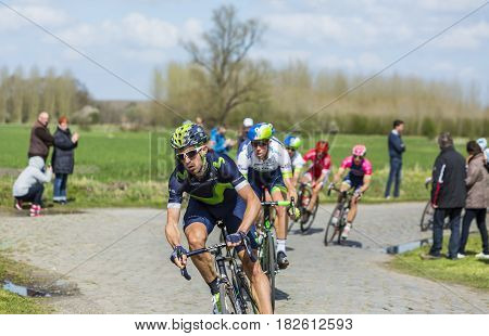 Hornaing France - April 102016: The Spanish cyclist Imanol Erviti of Movistar Team riding in the peloton on a paved road in Hornaing France during Paris Roubaix on 10 April 2016.