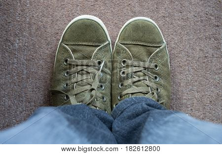 Top View Green deerskin shoes On the carpet