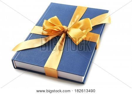 Book with ribbon as gift on white background