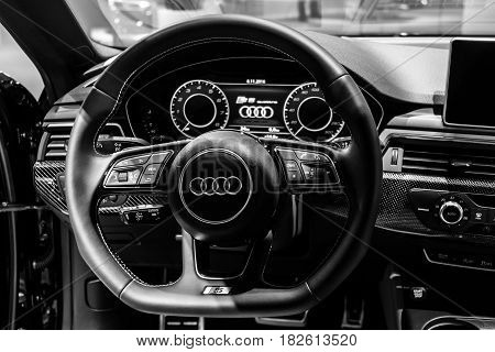 BERLIN - NOVEMBER 09 2016: Showroom. The dashboard of the compact executive car Audi S5 Sportback 3.0 TFSI quattro tiptronic. Black and white. Produced since 2013 (facelifted).