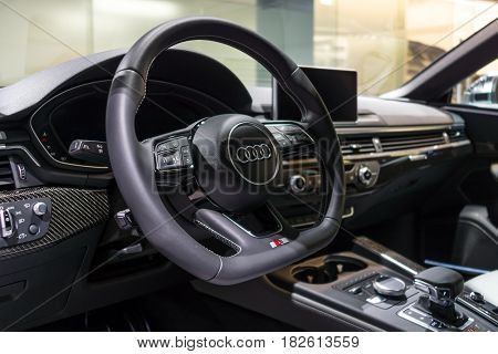 BERLIN - NOVEMBER 09 2016: Showroom. The dashboard of the compact executive car Audi S5 Sportback 3.0 TFSI quattro tiptronic. Produced since 2013 (facelifted).