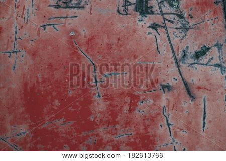 Red rusted metal background and texture. Red grunge old rusty scratched surface. Background of old metal surface. Red abstract metal background and texture for designers. Macro view of red metal.