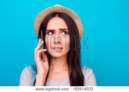 Close Up Portrait Of Pretty Troubled Woman Biting Lips And Asking For Help On Smartphone