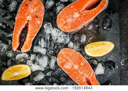 Raw Salmon Steaks On Ice