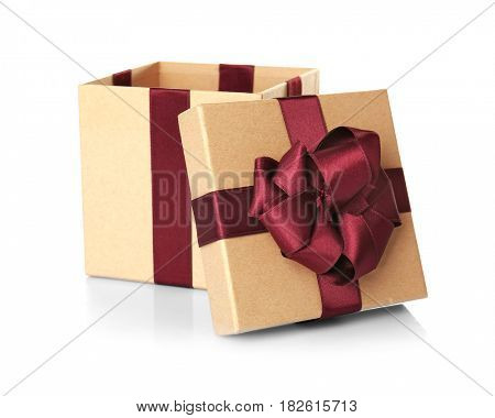 Open beige gift box with vinous ribbon on white background
