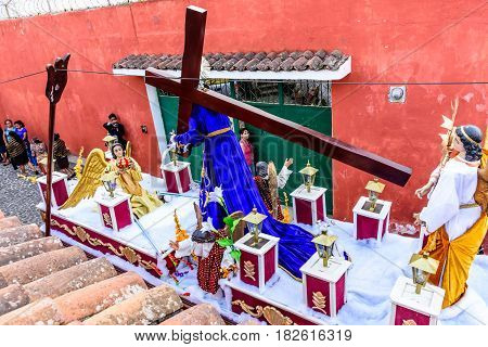 San Juan del Obispo, Guatemala - April 8 2017: Rooftop view of Holy Week procession passing in small town near Antigua, Guatemala, Central America