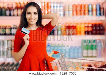 Happy Customer Holding Credit Card in a Supermarket