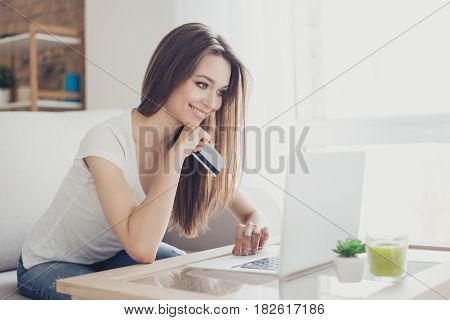 Shopper Girl Is Buying Online With A Laptop And Credit Card Sitting In Nice Light Room