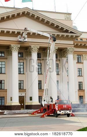 Tyumen, Russia - September 15, 2007: Builders by fire autotower make repair of building facade of Tyumen region Government