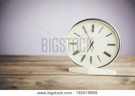 Modern black clock on table in the office