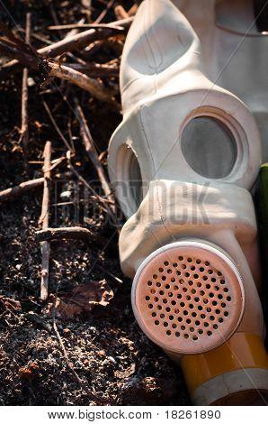 A Gasmask On Burnt Ground