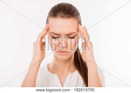 Close Up Photo Of Tired Unhappy Woman Isolated On White Background Touching Her Temples While Having