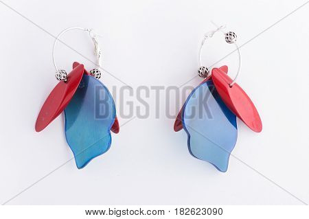 Colorful handmade bright earrings isolated on white background